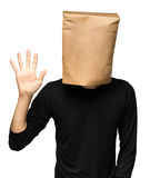 Man covering his head using a paper bag. five Stock Images