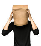 Man covering his head using a paper bag. Man thinking Royalty Free Stock Photography
