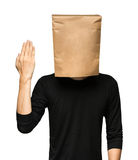 Man covering his head using a paper bag. Stock Image