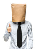 Man covering his head using a paper bag. Royalty Free Stock Image