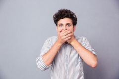 Man covering his mouth Stock Photos