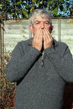 Man covering his mouth with his hands. royalty free stock photos
