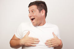 Man covering his nipples Royalty Free Stock Photos