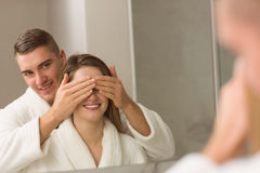 Man covering his pretty girlfriends eyes Royalty Free Stock Photo