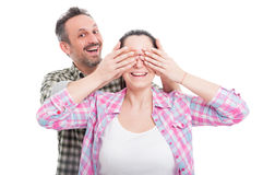 Man covering his woman eyes making a surprise Royalty Free Stock Photos