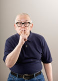 Man covering mouth gesturing Stock Image