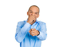 Man covering mouth, pointing and laughing Stock Photo