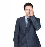 Man covering one eye , standing isolated on white Stock Image