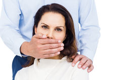 Man covering wifes mouth Royalty Free Stock Photos