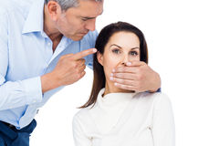 Man covering wifes mouth Stock Photography