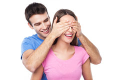 Man covering woman's eyes with his hands Royalty Free Stock Photography