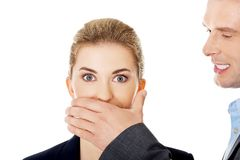 Man covering woman's mouth Royalty Free Stock Photos