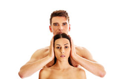 Man covering women`s ears Royalty Free Stock Photo