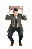 Man covers the head with a suitcase Royalty Free Stock Photo