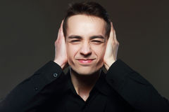 Man covers his ears Royalty Free Stock Photography