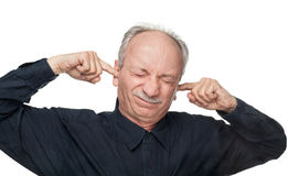 Man covers his ears with his hands Stock Photos
