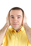 Man covers his ears with his hands Stock Photography