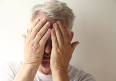 Man covers his face Stock Photography