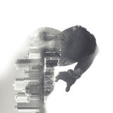 Man covers his face from some danger, cityscape collage Royalty Free Stock Image