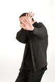 Man covers his face and standing isolated on white background. Young man covers his face and standing isolated on white background Stock Images