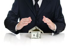 Man covers the house money Stock Image