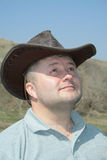 Man with cowboy hat. Looking and thinking Royalty Free Stock Photo