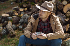 Man cowboy hat drinking morning coffee in countryside Stock Photography