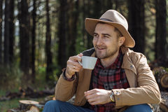 Man cowboy hat drinking morning coffee in countryside Royalty Free Stock Photography