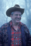 A man in a cowboy hat and flannel shirt smiling, Monticello, VA Stock Photo