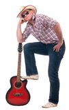 Man with cowboy hat and guitar. Pretty man with cowboy hat and guitar on white background Royalty Free Stock Photo