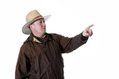 Man in cowboy hat and oilskin coat. Middle aged man in cowboy hat and oilskin coat Stock Images