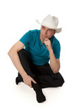 Man in a cowboy hat sitting in the lotus position Royalty Free Stock Image
