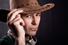 Man with cowboy hat. And a toothpick Stock Images