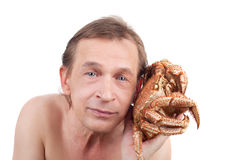 Man and crab Stock Photos