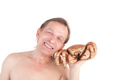 Man with crab Stock Photos