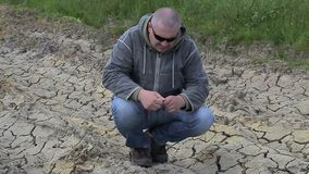 Man on cracked dry ground stock video footage