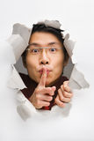 Man from cracked wall tell you to be quiet Stock Image