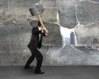 Man cracking old concrete wall Stock Photography
