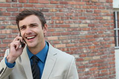Man cracking up after listening to joke on mobile phone.  Stock Images