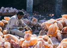 A man crafting salt lamps Stock Photos