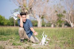 Man with crashed drone Stock Images