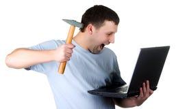man crashing laptop Royalty Free Stock Images