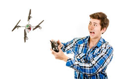 Man crashing a quadcopter drone. Man playing with a quadcopter drone royalty free stock photo