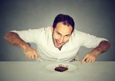 Man craving sweet food pound cake royalty free stock photo