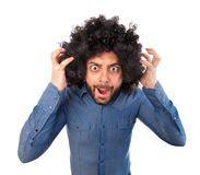 Man with crazy expression and puffy hair Royalty Free Stock Images