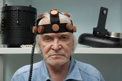 Man crazy inventor wearing a helmet brain research Royalty Free Stock Photo