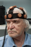 Man crazy inventor wearing a helmet brain research Stock Image