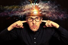 Man crazy inventor wearing a helmet brain research royalty free stock image