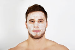 Man with cream moisturizer on his face. Stock Image