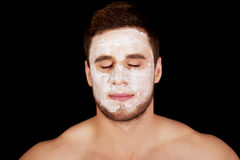 Man with cream moisturizer on his face. Stock Images